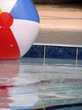 Beach Ball in the Pool. Closeup of a beach ball in the pool royalty free stock photos