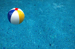 Beach ball in pool. Colorful beach ball in swimming pool Royalty Free Stock Images