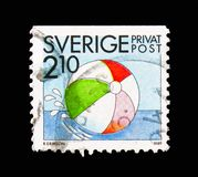 Beach ball, Rebate stamps - Summer Activities serie, circa 1989. MOSCOW, RUSSIA - AUGUST 18, 2018: A stamp printed in Sweden shows Beach ball, Rebate stamps royalty free stock image