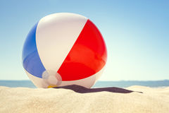 Beach ball on the sand stock photography
