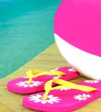 Beach ball and sandals on dock Stock Photography