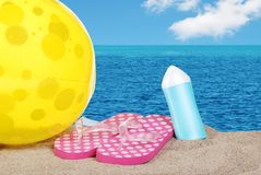 Beach ball sandals and suntan lotion Stock Photography