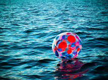 Beach Ball at Sea Royalty Free Stock Photography