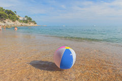 Beach ball in sea Stock Photos
