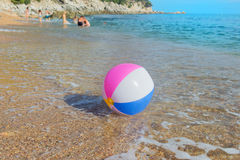 Beach ball in sea Stock Images