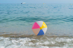 Beach ball in sea Royalty Free Stock Photos