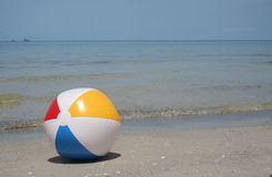 Beach ball on the seashore Royalty Free Stock Photo
