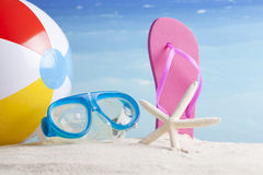 Beach ball and snorkel mask on the beach Stock Photos