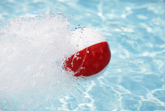 Beach Ball Splashing Water Royalty Free Stock Image