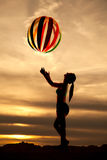 Beach ball sunset Stock Image