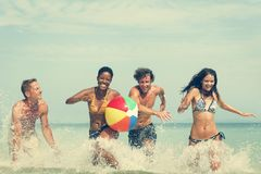 Beach Ball Sunshine Vacation Tropical Summer Concept. Diverse Friends Beach Swimming Fun Concept royalty free stock photography