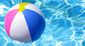 Beach Ball In Swimming Poll Royalty Free Stock Image