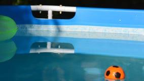 Beach Ball in Swimming Pool stock footage