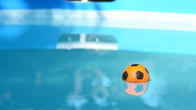 Beach Ball in Swimming Pool stock video footage
