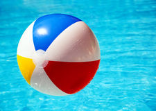 Beach ball in swimming pool Royalty Free Stock Photos