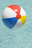 Beach Ball in Swimming Pool Vertical Stock Images