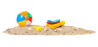 Beach ball,towels and toys. Beach sand with shells, toys, ball and towels Stock Photo