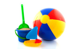 Beach ball with toys. Beach ball with colorful toys on white background Royalty Free Stock Photography