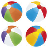Beach ball variety. A selection of beach balls in multiple colors isolated on white Royalty Free Stock Photos