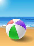 Beach ball. Vector colorful beach ball on the sand, eps10 file, gradient mesh and transparency used Stock Photography