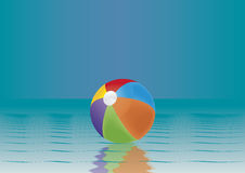 Beach ball in water Royalty Free Stock Photos