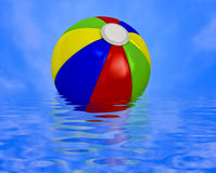 Beach ball on water Royalty Free Stock Photography