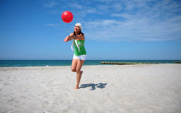 Beach ball woman jumping Royalty Free Stock Photos