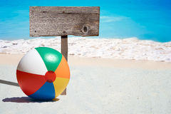 Beach Ball and wooden Signboard Royalty Free Stock Photos
