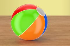 Beach ball on the wooden table. 3D rendering. Beach ball on the wooden table. 3D Royalty Free Stock Photos