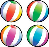 Beach balls. Four round striped beach balls Stock Photography