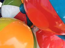 Beach balls cluttered together. As prizes at a fair in daylight Stock Images