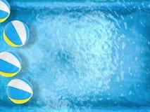 Beach balls floating on pool Stock Photo