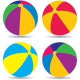 Beach balls. Four beach balls on white background stock illustration