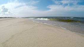 Beach of the Baltic Sea in Poland. With surf stock footage