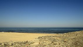 Beach of the Baltic Sea in Poland. With surf and blue sky stock video