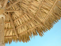 Beach bamboo umbrella Stock Image