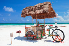 Beach bar bike. Exotic beach bar transformed from bike at Caribbean beach in Mexico Stock Photos