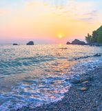 Beach of Bar city at sunset,Montenegro. Beautiful evening seascape in summer seaside resort royalty free stock photography