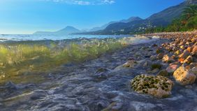 Beach of Bar city at sunset,Montenegro. Evening seascape with transparent wave in summer royalty free stock photography
