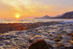 Beach of Bar city at sunset,Montenegro. Evening seascape with transparent wave in summer royalty free stock images