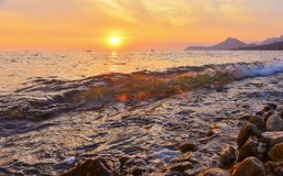 Beach of Bar city at sunset,Montenegro. Evening seascape with transparent wave in summer stock photos