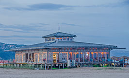Beach Bar near sea water, lights, night time, party time. Albena, Bulgaria Stock Photo