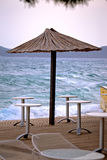 Beach bar parasol by rough sea Stock Image