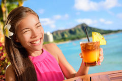 Beach bar party drinking friends toasting Mai Tai. Beach bar party drinking friends toasting Hawaiian sunset cocktails having fun. Asian woman looking at camera Stock Photos