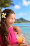Beach bar party drinking friends toasting Mai Tai. Beach bar party drinking friends toasting Hawaiian sunset cocktails having fun. Asian woman looking at camera Stock Images