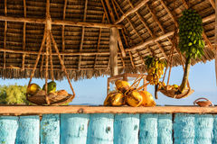 Beach Bar. In the picture beach bar in Nungwi ( Zanzibar ) at sunset , with exposed coconut , banana and tropical fruit .This bar is made with cane bamboo,wooden Royalty Free Stock Photos