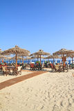 Beach bar by the sea. Beach bar with straw umbrellas and wooden deck on exotic resort Stock Photos