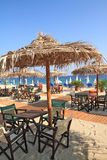 Beach bar by the sea. Beach bar with straw umbrellas and wooden deck on exotic resort Royalty Free Stock Photography