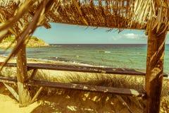 Beach bar with sea view. Vintage sea view reed bar table. Aegean Sea, Skiathos island, Greece, 2018 royalty free stock photos