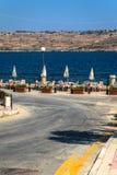 Beach Bar Tables. In a promenade in the coast of Malta Stock Photography